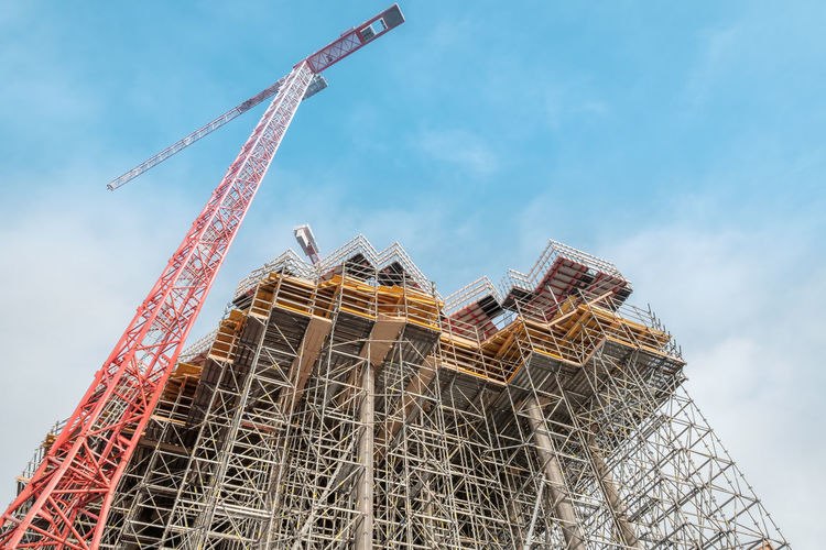 Architecture Building - Activity Building Exterior Built Structure Construction Construction Frame Construction Machinery Construction Site Crane Crane - Construction Machinery Day Development Growth Industry Low Angle View No People Outdoors Progress Red Crane Sky
