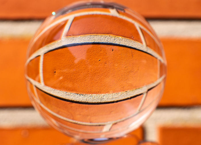 ball against the wall Glass - Material Orange Color No People Focus On Foreground Ball Crystal Ball Wall Brick Brick Wall Abstract Photography Looks Like