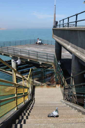 Architecture Bridge - Man Made Structure Built Structure Connection Day Deal Pier Hobby Horizon Over Water Kent Men Nature One Person Outdoor Pursuits Outdoors People Railing Real People Sea Sea Fishing Sky Steps Transportation Water