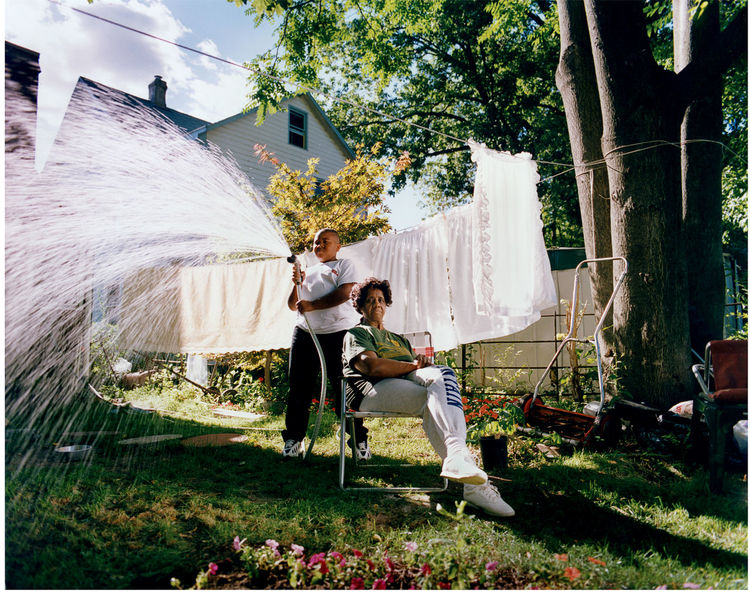 Portrait Environmental Portrait Backyard Grandson Laundry Architecture Building Exterior Built Structure Day Full Length Grandma Grass Hose Outdoors People Real People Togetherness Tree Young Adult