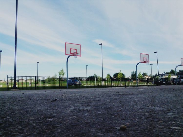 Road Transportation Street Light Street Car Sky Road Sign Cloud Basketball The Way Forward Pole Day Information Sign Outdoors Blue City Life Tranquil Scene Dividing Line