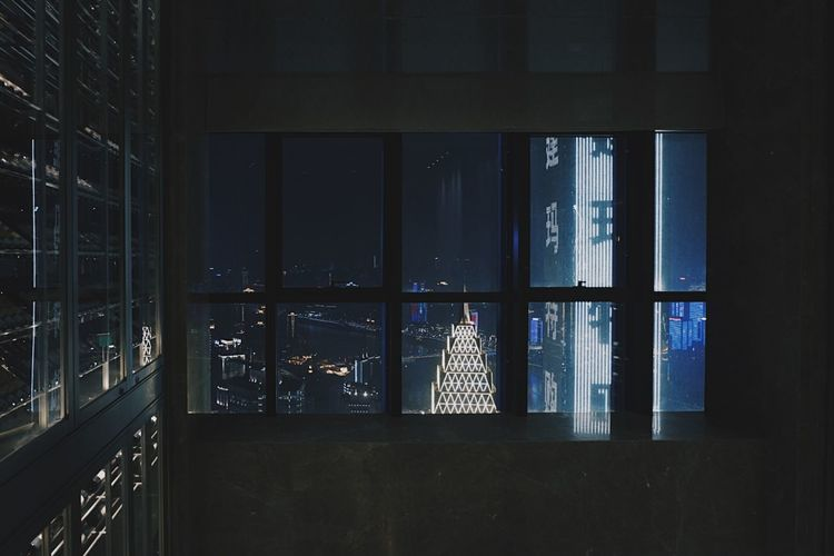 Reflection of building in glass window