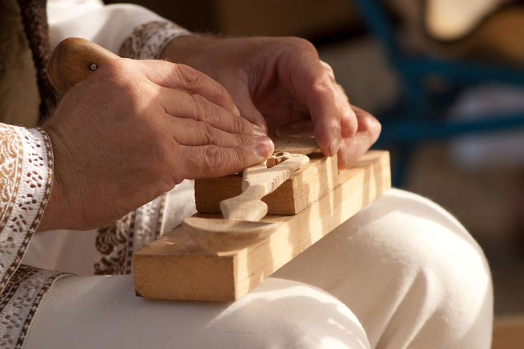 Carving - Craft Activity Close-up Day Focus On Foreground Holding Human Body Part Human Hand Indoors  Instrument Maker Men Musical Instrument Occupation One Person People Real People Senior Adult Skill  Wood - Material Working Workshop