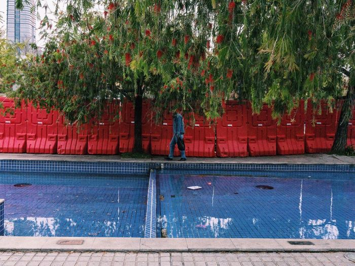 Shenzhen, China 2019 Streetphotography Street Of China Mobilephotography IPhoneography Iphone6s VSCO Water Plant One Person Day Real People Tree Nature Full Length Outdoors Men Unrecognizable Person Architecture Footpath
