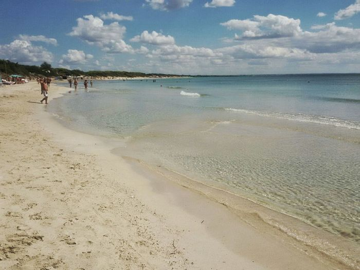 Spiaggia di Punta Prosciutto. Punta Prosciutto Puglia Italia Italy Beach Sand Sea Coastline Water Vacations Summer Travel Destinations Incidental People Full Length Sky Tranquility Tourism Water's Edge Tranquil Scene Nature Cloud - Sky Horizon Over Water Day Android Photography Smartphone Photography