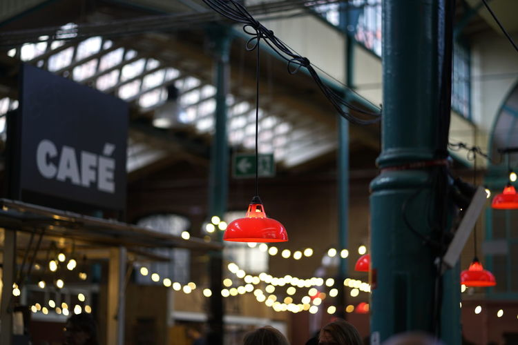 Markthalle Neun Markthalle Neun Illuminated Lighting Equipment Red Architecture Hanging Focus On Foreground Built Structure Low Angle View Text Building Exterior Ceiling No People Communication Western Script Outdoors Sign Light Selective Focus Decoration Consumerism
