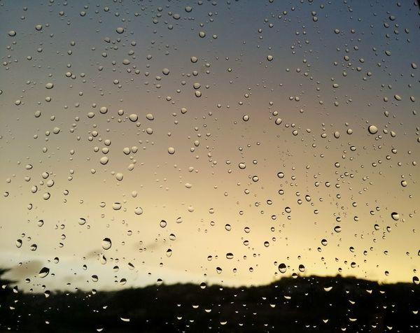 Nature Light Sky Ciel Beautiful Sunlight Tranquility Rain Rainy Days Rain Drops Gouttes De Pluie Goutte D'eau Beauty In Nature Calme Vacations Landscape No People Coucher De Soleil Water