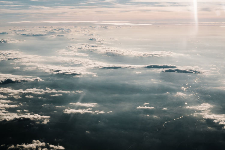 Aerial View Backgrounds Beauty In Nature Cloud Cloud - Sky Cloudscape Day Environment Fluffy Full Frame Heaven Idyllic Lens Flare Majestic Nature Scenics Sea Sky Sky Only Sun Sunbeam Sunlight Tranquil Scene Tranquility Water