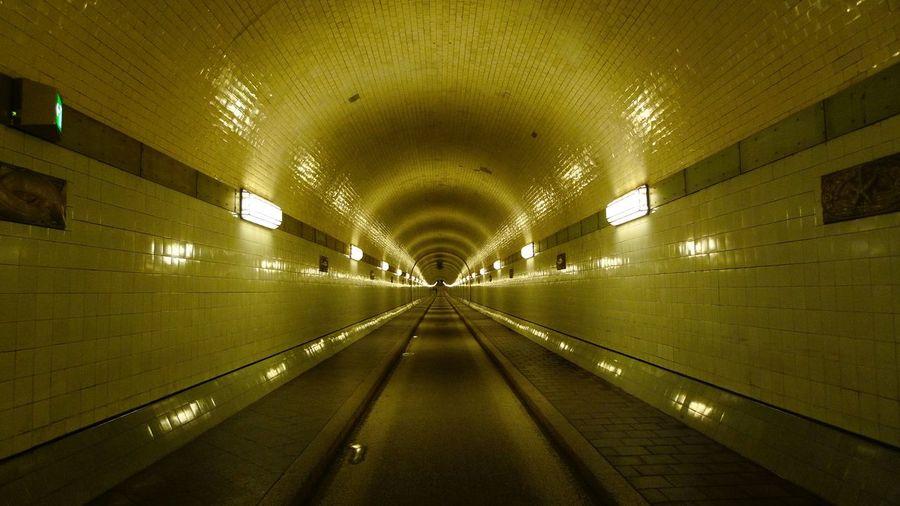 Interior of illuminated empty tunnel