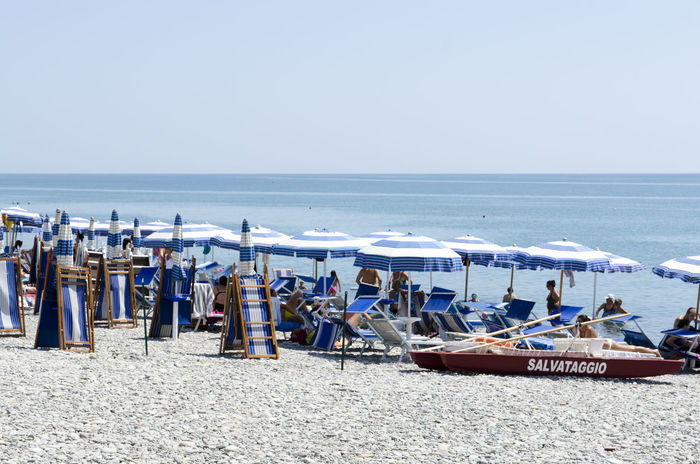 Beach Blue Boat Calabria Day Group Of Objects Horizon Over Water Italia Italy Nature Outdoors Parasol Scenics Sea Sea And Sky Shore Sky Summer Tranquil Scene Tranquility Vacations Water