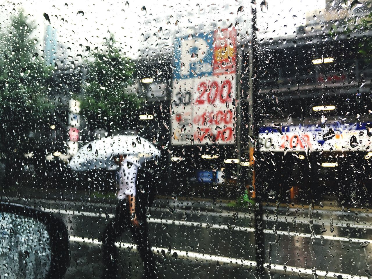 Road Seen Through Wet Window In Rainy Season
