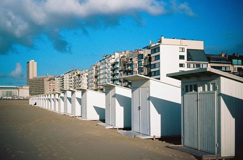 Ostende, Belgium. Belgian Beach Huts on Fuji Provia 100 Film I Film Photography Analogue Photography Architecture Built Structure Building Exterior Sky City Cloud - Sky Nature Day Building No People Outdoors Sunlight Blue Beach Street Residential District Modern Travel Destinations History