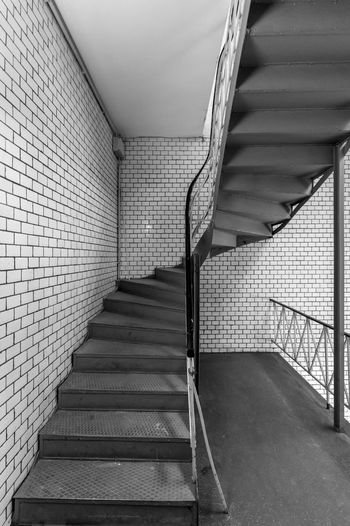 Black And White Architecture Best Of Stairways Railing Staircase Steps And Staircases Indoors  Built Structure The Way Forward No People Direction Wall - Building Feature Empty Building Absence Wall Pattern Ceiling Flooring Illuminated Metal Diminishing Perspective Underground Walkway Underpass