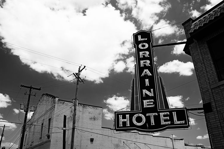 Advertising Architecture Built Structure Cable Clouds And Sky Historical Building History Hotel Information Sign Memphis Neon Sign No People Power Line  Tennessee lorraine