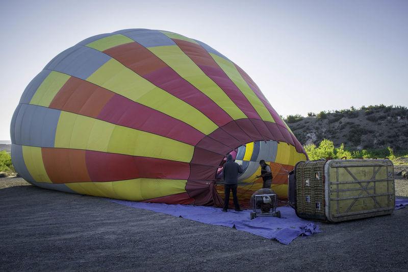 Man hot air balloon against clear sky