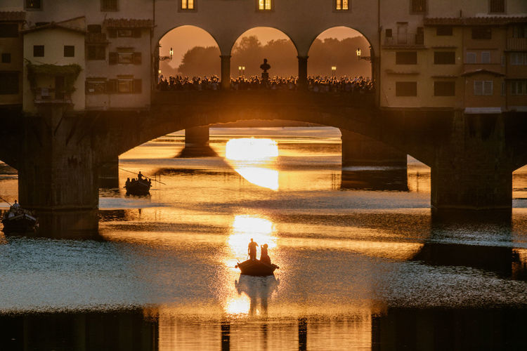Ponte Vecchio Tourist Attraction  River Skiffs Sunset Tranquil Scene Water