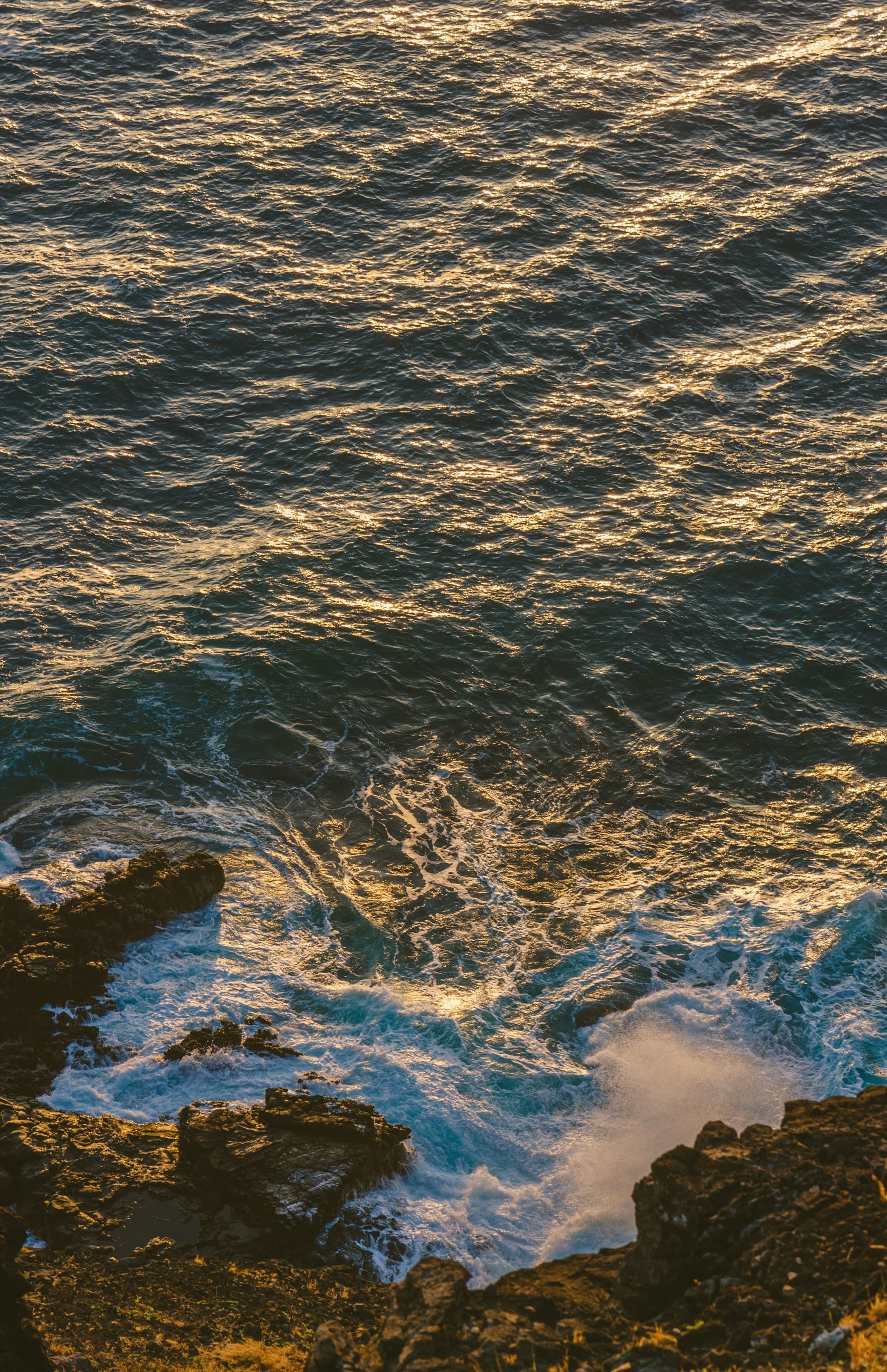 water, high angle view, nature, beauty in nature, tranquility, scenics, sea, tranquil scene, full frame, beach, rippled, backgrounds, wave, waterfront, outdoors, surf, shore, reflection, aerial view, idyllic
