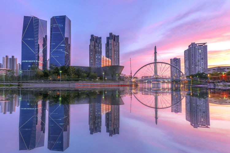 INCHEON, KOREA Songdo Central Park in Incheon, South Korea Architecture Building Building Exterior Built Structure City Cityscape Dusk Financial District  Landscape Modern Nature No People Office Building Exterior Outdoors Reflecting Pool Reflection Sky Skyscraper Symmetry Tall - High Tower Urban Skyline Water Waterfront