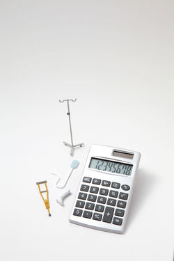 Hospitalization InFusion Care Gibbs Hospital Accident Bandages Calculation Calculator Clinic Copy Space Crutches Disability  Health Injury Insurance Medical Miniature No People Patient Sick Studio Shot Toy White Background Wounds