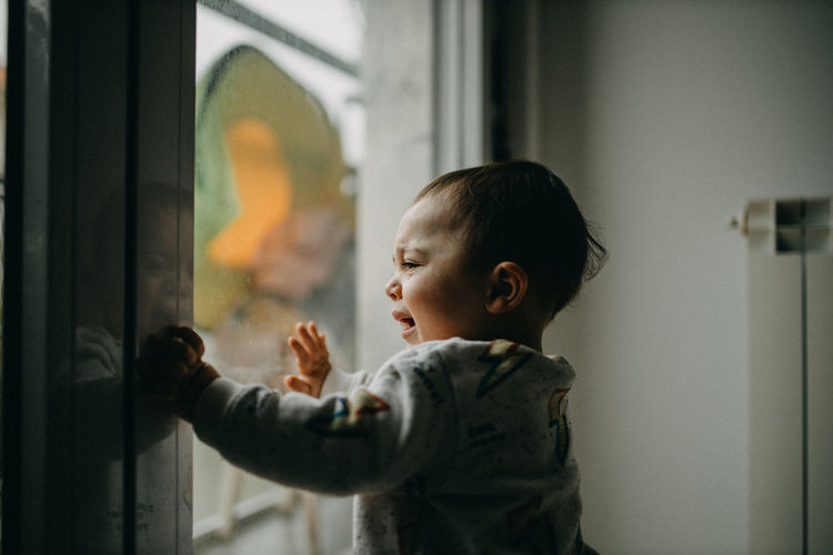 Toddler crying at the window
