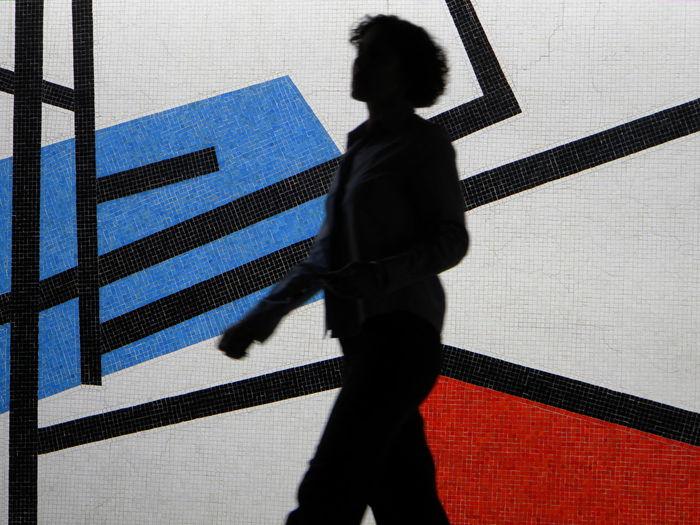 Shadow of woman walking on wall