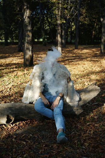 -with @matthias4 Smoke Smoke - Physical Structure Smoking Smoking - Activity Vape Vaping One Person Men Tree Full Length Men Shadow Woods Tree Trunk WoodLand Fallen Tree Forest Wearing