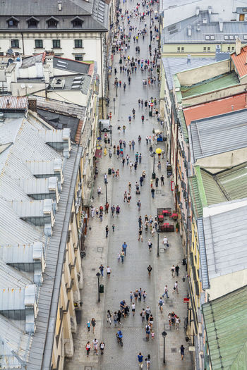 High Angle View Of People Walking On Street In City