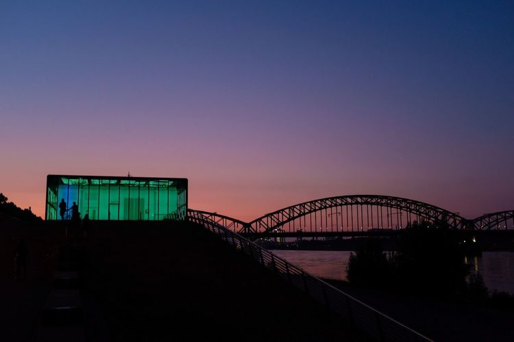Hochwasser Pumpwerk Green Architecture Built Structure Sky Bridge Connection Bridge - Man Made Structure Transportation Sunset No People Copy Space Silhouette Nature Water Building Exterior Dusk Outdoors Railing Travel City Arch Bridge