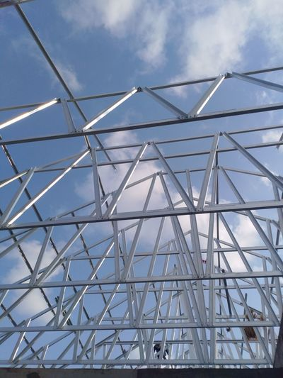 Construction in the sky Built Structure Architecture Sky Low Angle View Day Pattern Cloud - Sky Nature Glass - Material Metal No People Modern Geometric Shape Design Outdoors Transparent Shape Blue Sunlight Reflection Glass Skylight Ceiling Steel