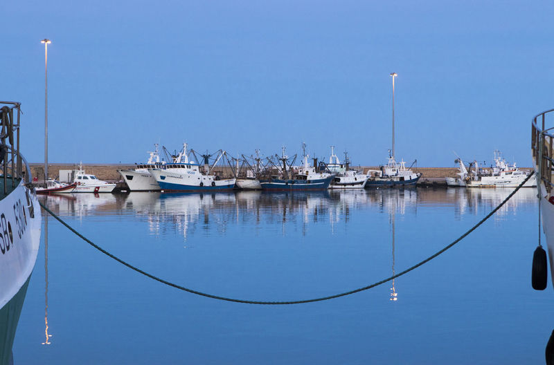 Reflection of boats on sea