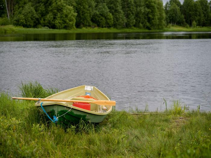 Boat moored at lakeshore