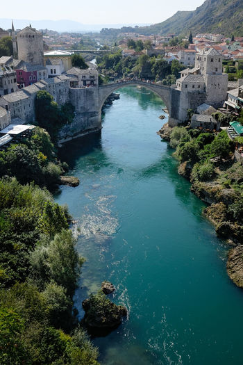 Elevated view of Mostar Bridge in Bosnia - portrait format Mostar Mostar Bridge Riverside Architecture Beauty In Nature Bridge Bridge - Man Made Structure Building Exterior Built Structure Day High Angle View Mountain Nature Outdoors River River Tara Scenics Stari Most Travel Destinations Tree Water