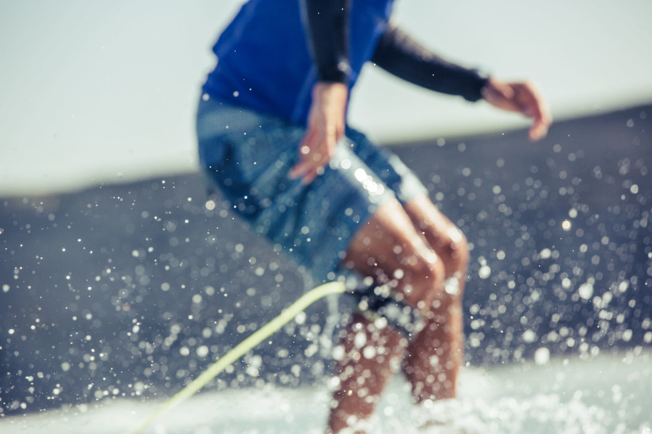 sport, motion, water, men, one person, lifestyles, splashing, leisure activity, focus on foreground, real people, sea, sportsman, outdoors, day, extreme sports, nature, athlete, one man only, close-up, adult, adults only, people