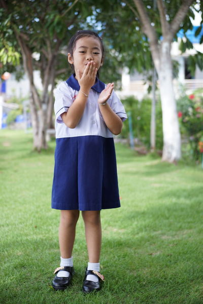 Khwan Khaw after school. Student Thai Thailand After School Child Childhood Day Females Focus On Foreground Front View Full Length Girl Girls Grass Innocence Kid Looking At Camera One Person Plant Portrait Pre-adolescent Child Real People Standing Student Uniform Tree Uniform Unifrom Women Young Adult The Portraitist - 2018 EyeEm Awards The Fashion Photographer - 2018 EyeEm Awards The Still Life Photographer - 2018 EyeEm Awards