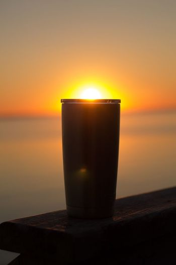 Tumbler Cup Sunset Flame Candle Sea Burning Sun No People Sky Table Water Close-up Tranquility Nature Horizon Over Water Scenics Beauty In Nature Outdoors