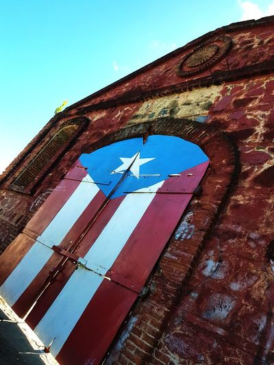Architecture Blue Sky Close-up Day Outdoors Red Skyscraper No People Clear Sky Low Angle View Built Structure Places I've Been Twoworldsphotography Twoworldspr Architecture Places Breathing Space Bridge - Man Made Structure Puertoricotourism Puertoricolohacemejor Flag Puerto Rico