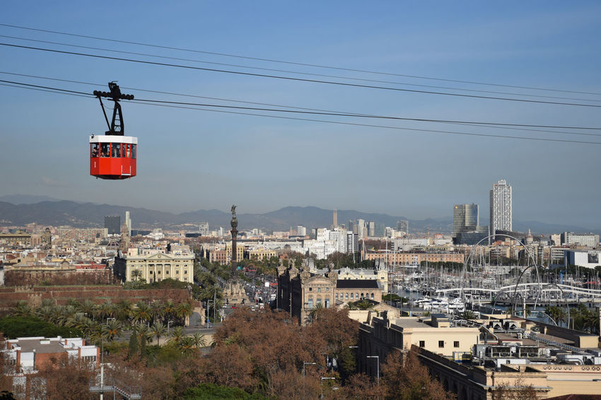Cable way over Barcelona city Transportation Architecture Building Building Exterior Built Structure Cable City Cityscape Day No People Overhead Cable Car Power Line  Sky Tourism Touristic Attraction