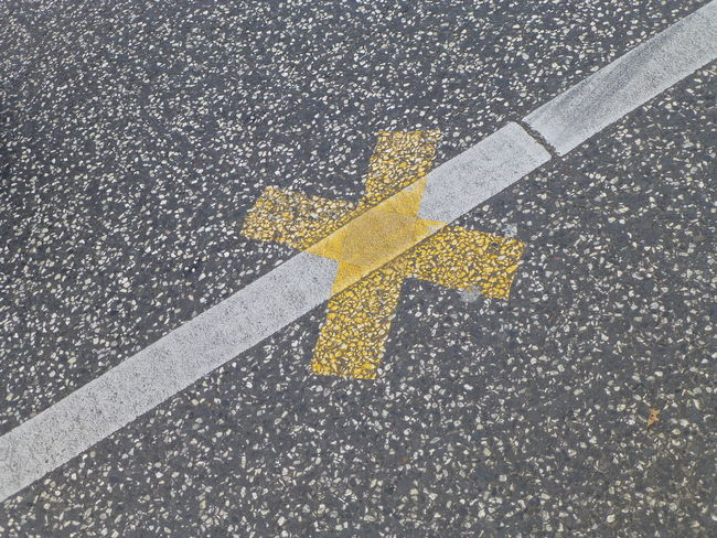 Cross Freedom Arrow Symbol Asphalt City Communication Day Direction Directional Sign Dividing Line Don't Guidance High Angle View Interdiction Marking No People Outdoors Road Road Marking Sign Street Symbol Transportation Yellow #FREIHEITBERLIN