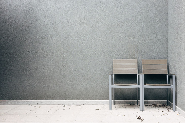 empty terrace in Brussels Seat Chair Wall - Building Feature Empty Absence Indoors  No People Copy Space Flooring Architecture Table Built Structure Gray Abandoned Wood - Material Furniture Day Sparse Office Wall Concrete Clean Terraced Field Chair Couple - Relationship Chroma Chromatic Pallet Grey