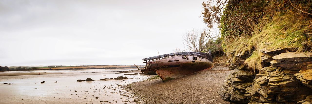 shipwrecked Panorama Water Nautical Vessel Sea Beach Sand Sky Deterioration Shipwreck Damaged Bad Condition Weathered Abandoned