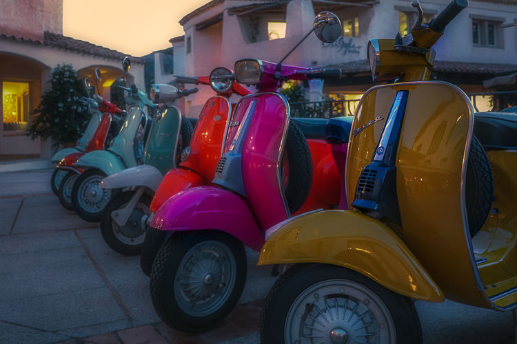 Vespa Scooter Italy Mode Of Transportation Transportation Land Vehicle Car Motor Vehicle Stationary City Day Architecture Wheel No People Parking Travel Outdoors Retro Styled Red Building Exterior Street Built Structure Tire Garage
