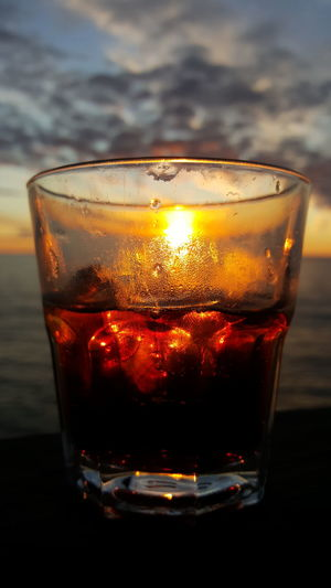Food And Drink Refreshment Glass - Material Close-up Transparent Drink Freshness Focus On Foreground Water Burning No People Indulgence Red Sunset_collection Scotch On The Rocks