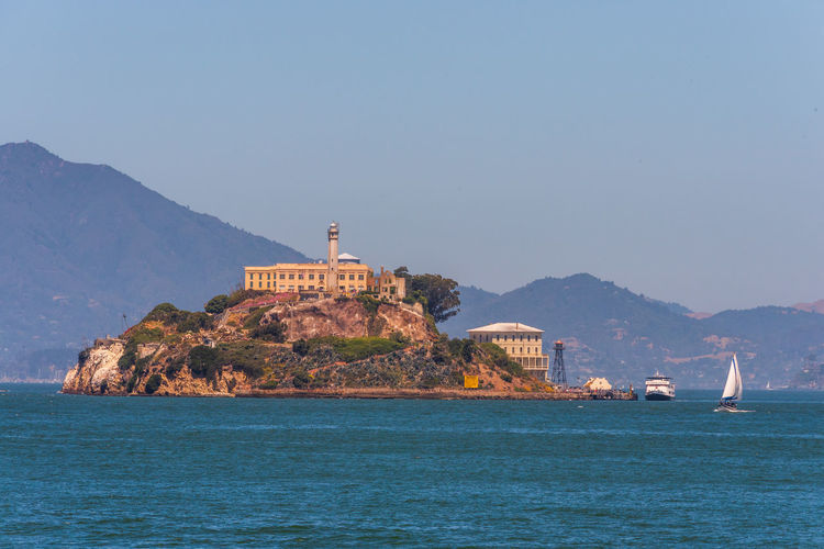 Alcatraz Prison Mountain Water Sea Sky Scenics - Nature Waterfront Architecture Nature Building Exterior Beauty In Nature Nautical Vessel No People Day Mountain Range Transportation Land Built Structure Mode Of Transportation Travel Outdoors Sailboat