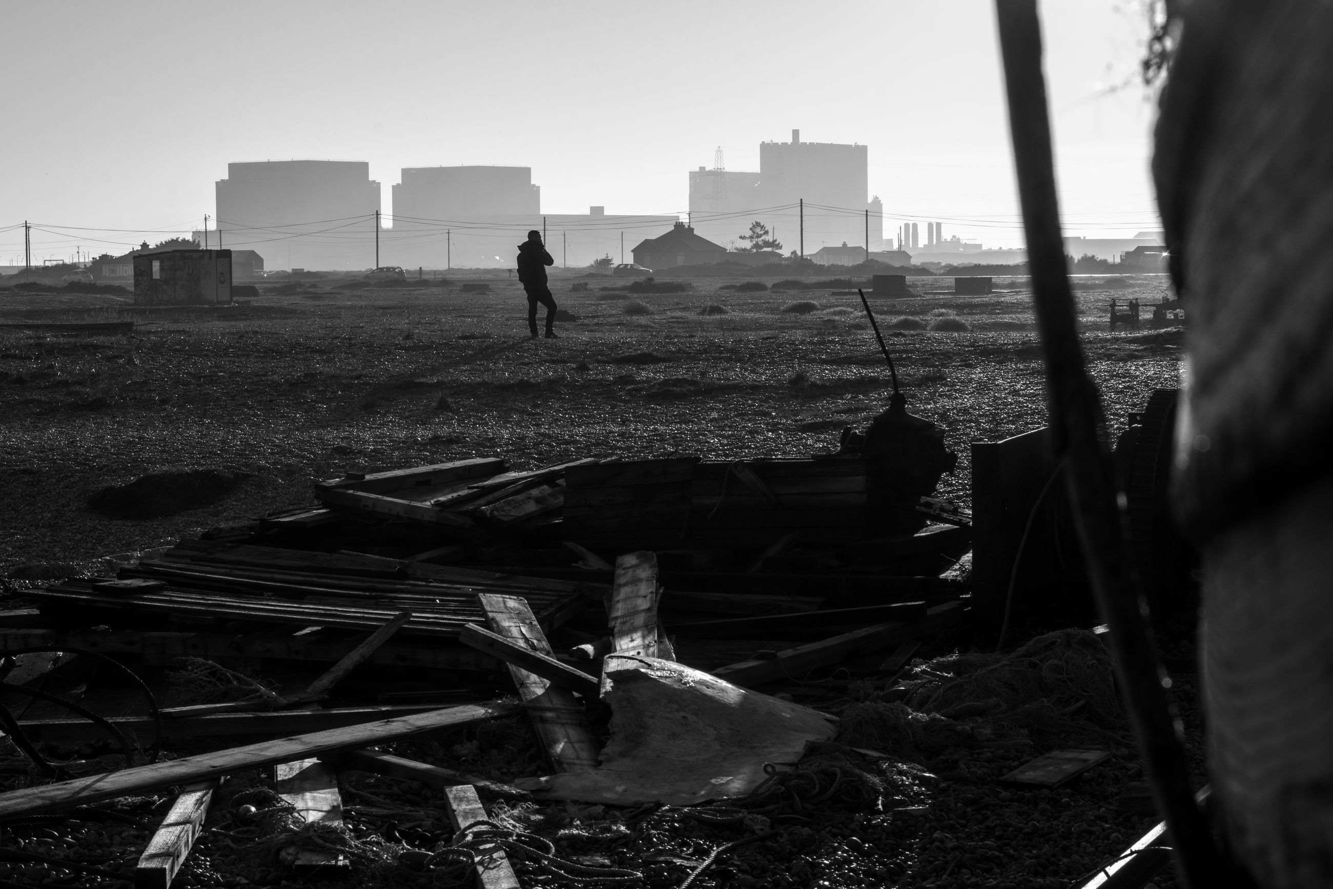 real people, architecture, field, land, built structure, sky, nature, building exterior, one person, day, men, abandoned, outdoors, standing, lifestyles, landscape, building, environment, full length, pollution, ruined