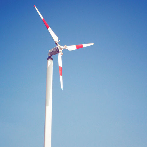 Copy Space Low Angle View Clear Sky Sky No People Day Environment Nature Blue Turbine Alternative Energy Wind Turbine Wind Power Environmental Conservation Renewable Energy Fuel And Power Generation Technology Lighting Equipment Red Pole Sustainable Resources Wind Windmill