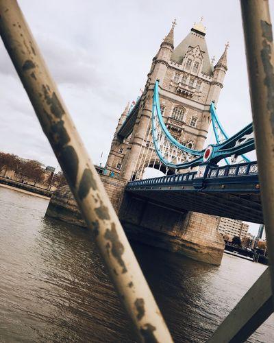 LOW ANGLE VIEW OF HISTORIC BRIDGE ACROSS RIVER