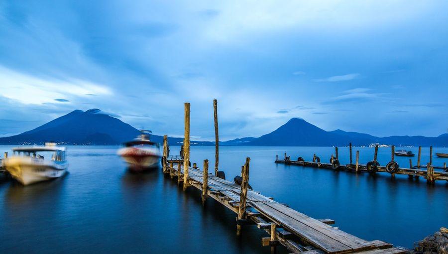 Lago Aticlan from Panajachel, Guatemala Panajachel  Lago Atitlán Guatemala EyeEm Selects Sky Transportation Water Mountain Cloud - Sky Nautical Vessel Scenics Harbor Sea Mountain Range