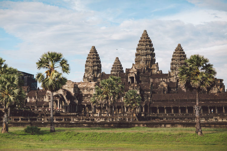 Siem Reap Cambodia Angkor Angkor Wat Angkor Wat, Cambodia Built Structure Architecture Religion History Place Of Worship The Past Belief Spirituality Travel Destinations Plant Sky Building Exterior Tree Travel Building Ancient Nature Tourism Grass No People Ancient Civilization Outdoors Archaeology Ruined