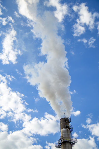 Destillery Air Pollution Alcohol Atmospheric Blue Building Exterior Built Structure Cloud - Sky Day Ecosystem  Emitting Environment Environmental Issues Factory Industry Low Angle View Nature No People Outdoors Pollution Sky Smoke Smoke - Physical Structure Smoke Stack Sugar Cane