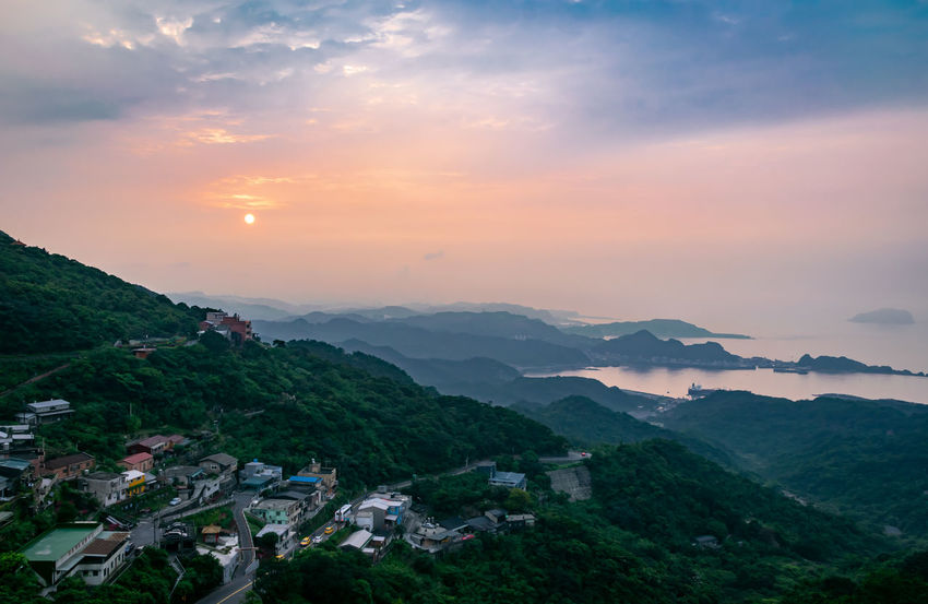 Sunset in Jiufen EyeEm Best Shots EyeEm Selects EyeEm Mountains Lovers Nature Sunset_collection Taiwan Travel Child Clouds And Sky Jiufen Landscape Mountain Range Mountains Orange Color Outdoors Sun TOWNSCAPE Village